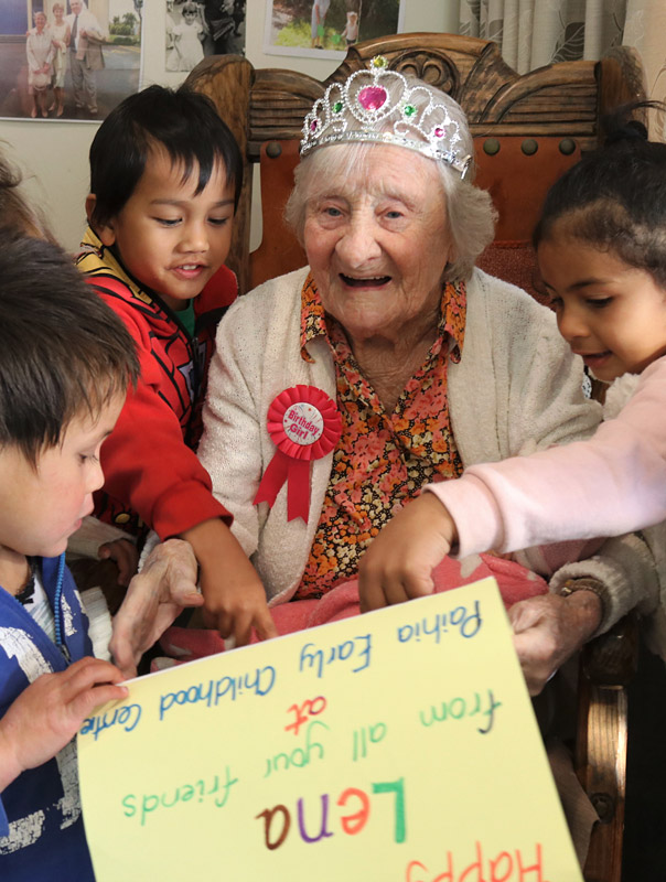 JUNE: Lena Walker, of Haruru Falls, celebrates her 107th birthday with little friends from a nearby childcare centre. Photo: Peter de Graaf