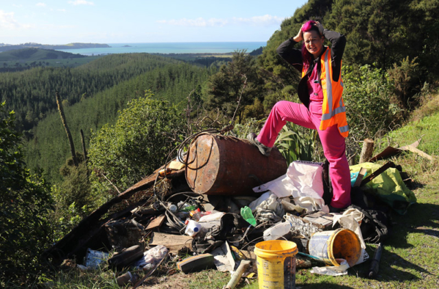 JULY: Tiffany Holland fumes at illegal rubbish dumping in Waitangi Mountain Bike Park. Photo: Peter de Graaf