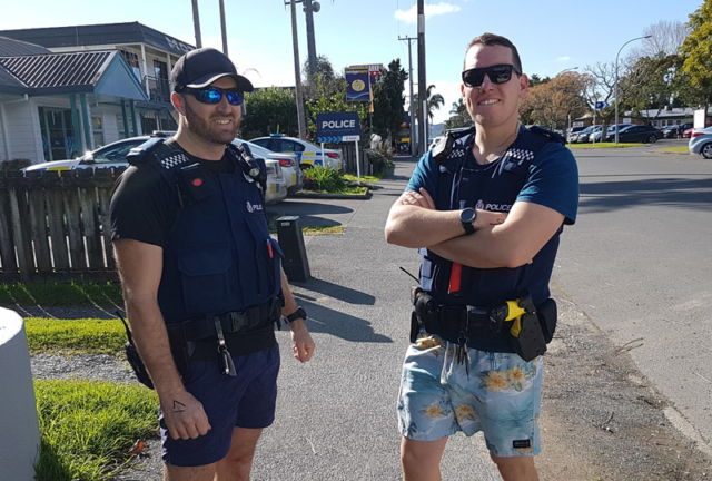 JUNE: Sergeant Rob Eke and Constable Tal Easton still in togs after nabbing a wanted man during a mid-winter swim. Photo: Peter de Graaf