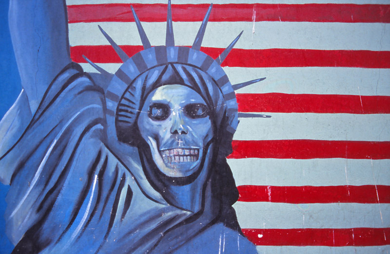 "Mural on the wall of the former US embassy in Tehran, now officially called ""the US Den of Espionage"""
