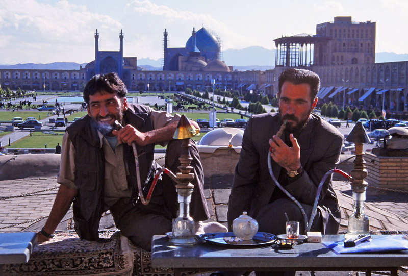 Men smoke waterpipes at a tea house overlooking Imam Square, Esfahan