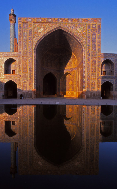 An iwan (portal) of the 17th century Imam Mosque is reflected in a pool, Esfahan