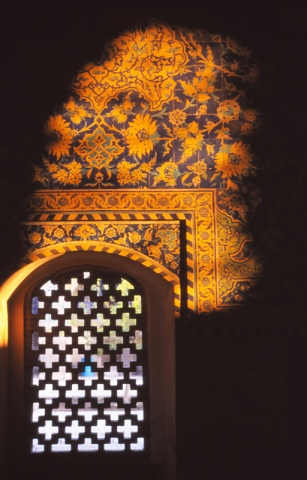 A patch of sunlight illuminates tilework inside the Imam Mosque, Esfahan
