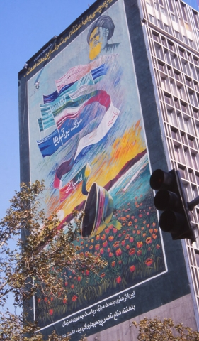 A mural honouring martyrs of the Iran-Iraq war covers the side of a building in Tehran