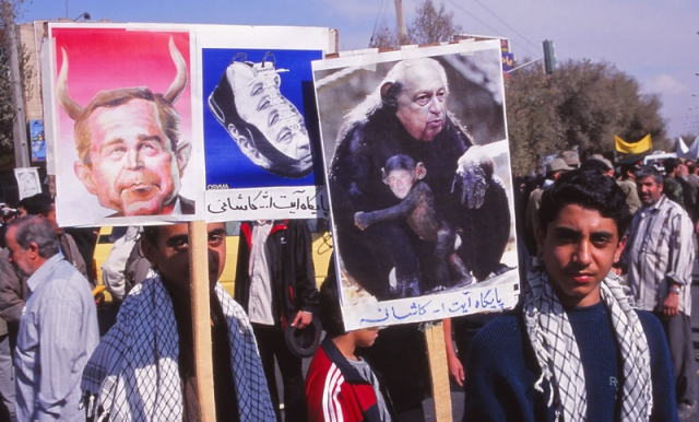 Protesters carry caricatures of US president George W Bush and Israeli Prime Minister Ariel Sharon