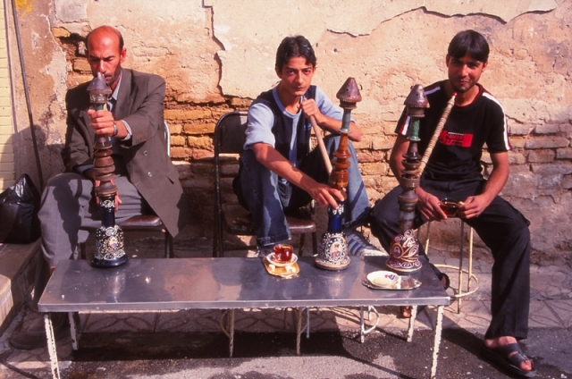 Men enjoying a qalyan (waterpipe) at a café in Shiraz