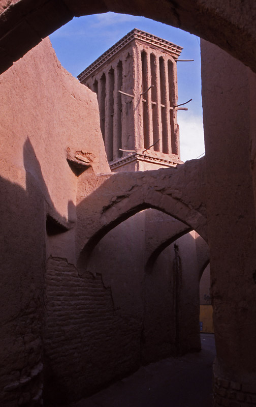 An alleyway and wind tower, an ancient form of air conditioning, in Yazd