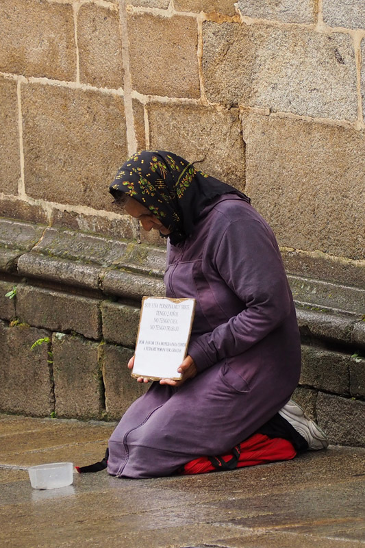 A beggar in Santiago de Compostella is a reminder of Spain's economic woes