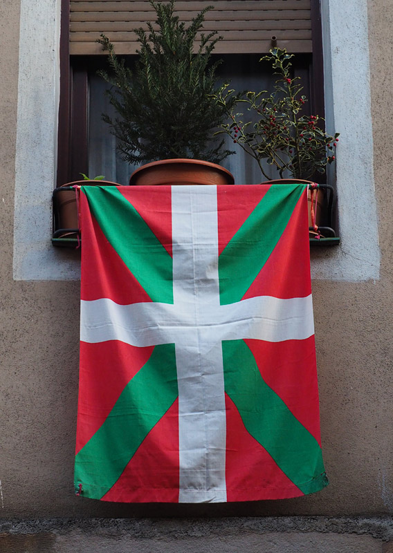 The Basque flag hangs from a window in Bilbao's old town, Spain