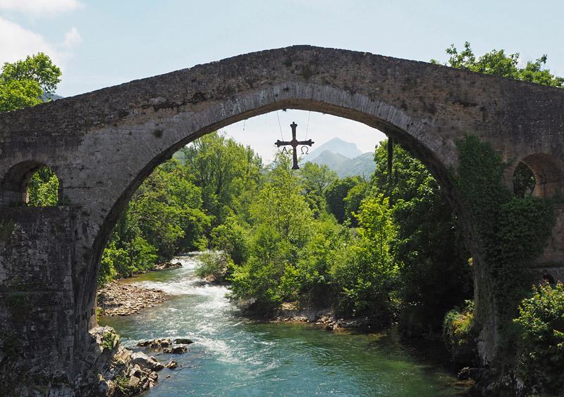 """The 13th century Puente Romano (""""Roman Bridge"""") in Cangas de Onís, Spain"""