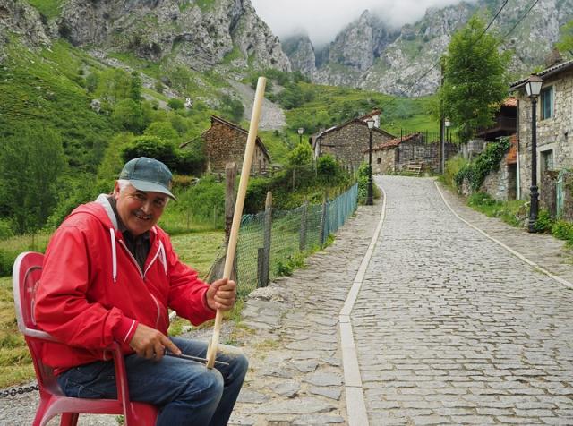 A man works on a walking stick in Caín, a village in Garganta del Cares (Cares Gorge)