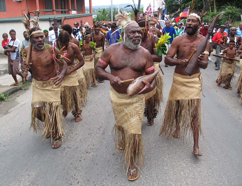 Traditional drummers march through Port Vila ahead of a ceremony marking 150 years of blackbirding