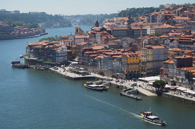 Bustling river front in Porto, he city that gave Portugal – and port wine – its name
