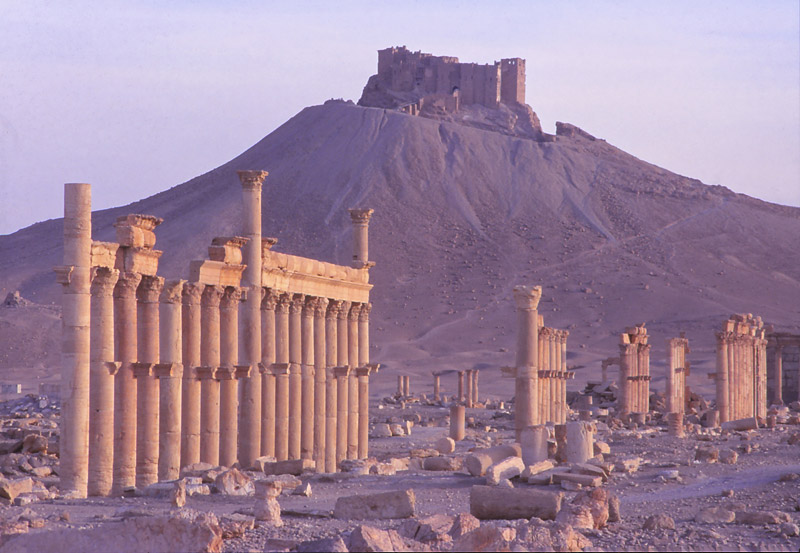 A 13th century Arab castle towers over Roman ruins at Palmyra