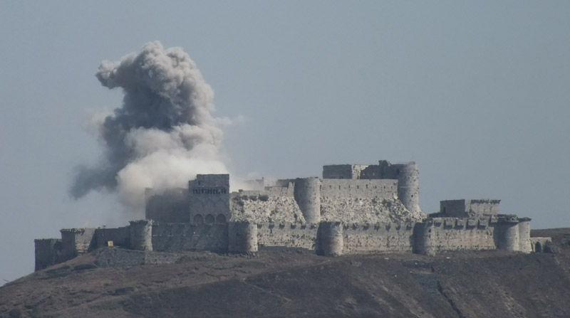 Krak des Chevalliers is hit by a shell in 2013. Photo: Syria963