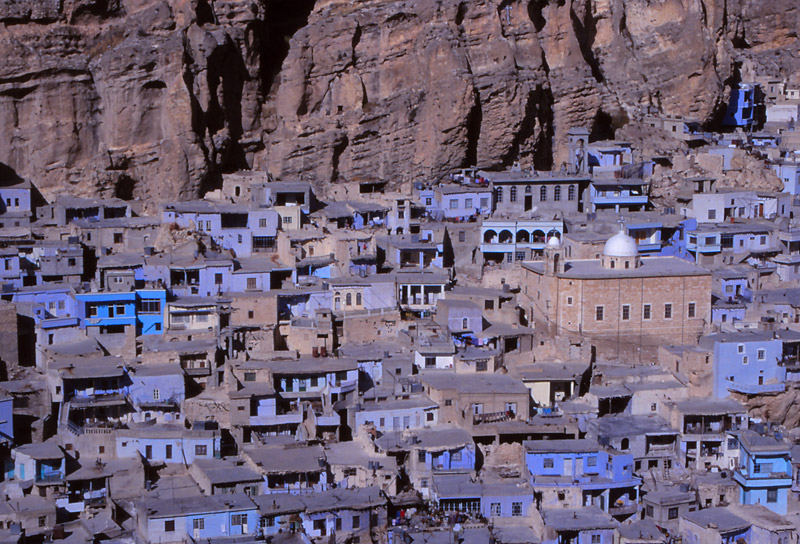 Maaloula's houses are wedged against a cliff in the mountains north of Damascus