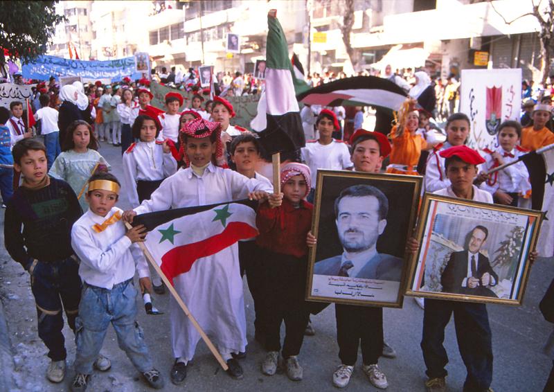 Children march for Hafez Assad's 25th anniversary as president, 1995