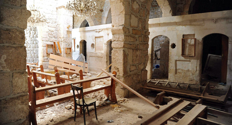 Damage inside Mar Sarkis Monastery in 2014. Photo: AFP