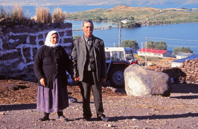 Mustak Cimşit and his wife outside their home in Akçakale village