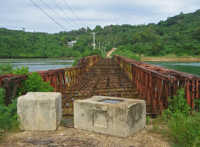A broken bridge over Vaipuna Inlet, Vava'u