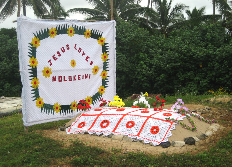 A grave on Vava'u Island decorated with a traditional Tongan quilt
