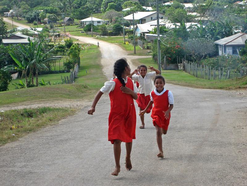 Schoolchildren spot a camera on Foa Island