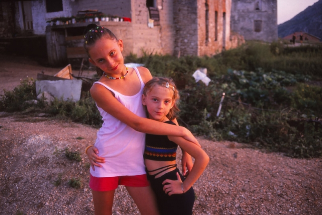 Bosnia, 1999: Girls play in a war-damaged quarter of Mostar