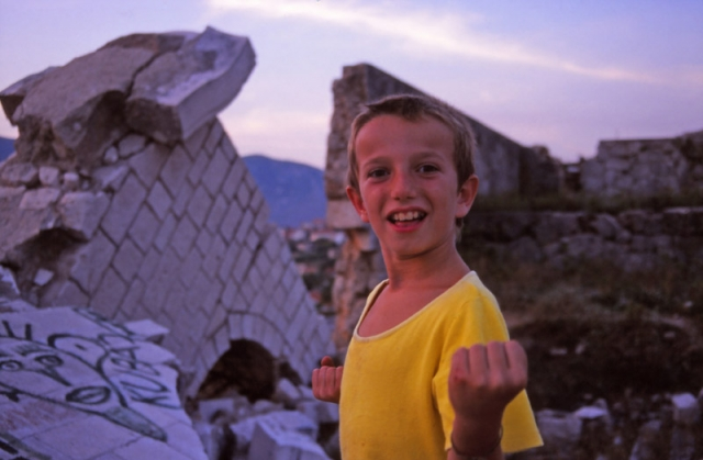 Bosnia, 1999: A Bosnian boy plays in the ruins of Mostar
