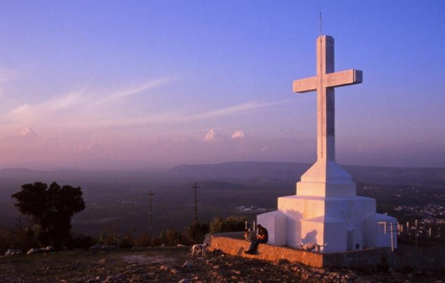 Bosnia, 1999: A cross atop Apparition Hill in Medjugorje, where pilgrims believe the Virgin Mary appeared in 1981