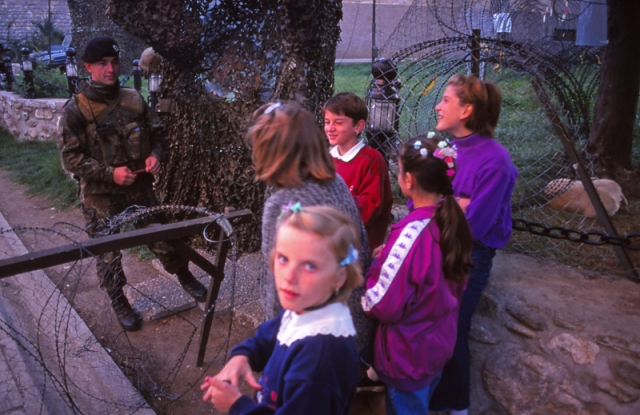 Kosovo, 1999: Girls talk to German peacekeepers in Prizren