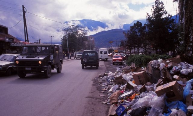 Kosovo, 1999: Rubbish piles up on the streets of Pejë after the Kosovo War