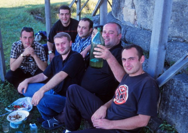 Georgian men celebrate a birthday with home-made wine in Kuitaisi