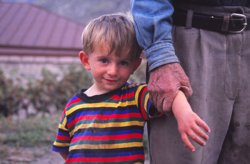 A boy and his grandfather in the village of Tmogvi