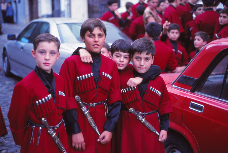 Young choir members await their turn on stage during a polyphony symposium in Tbilisi