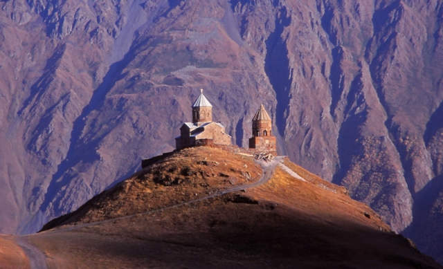 The 14th century Tsminda Sameba (Holy Trinity) Church perches on a 2170m-high peak in the Caucasus Mountains
