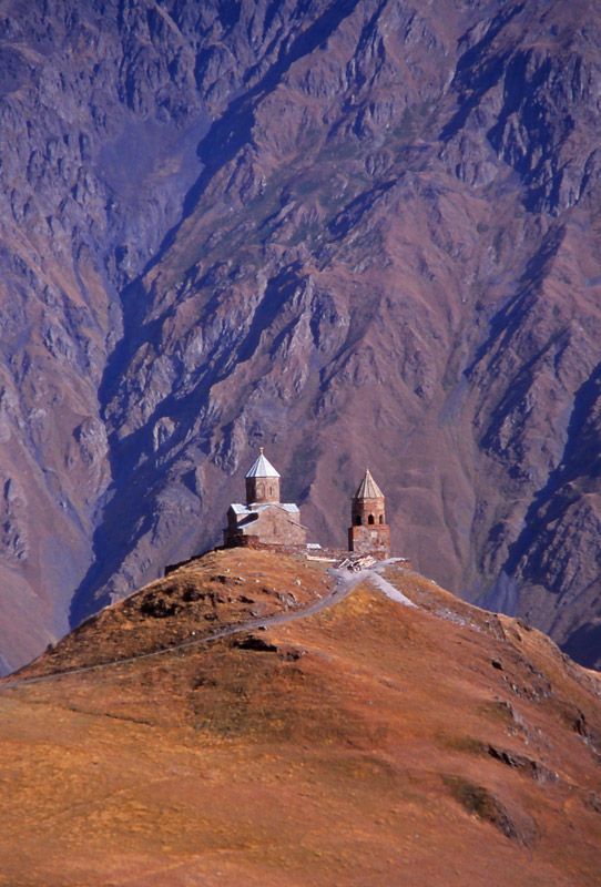The 14th century Tsminda Sameba Church perches on a 2170m-high peak in the Caucasus Mountains