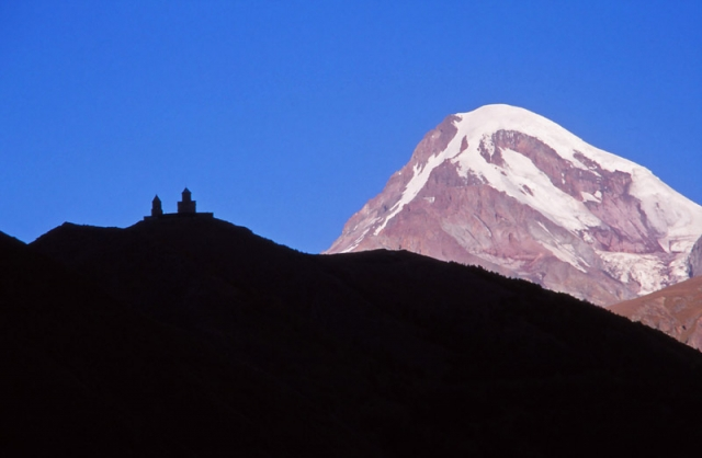 The 14th century Tsminda Sameba Church is dwarfed by Mt Kazbek, at 5047m the third highest mountain in Georgia