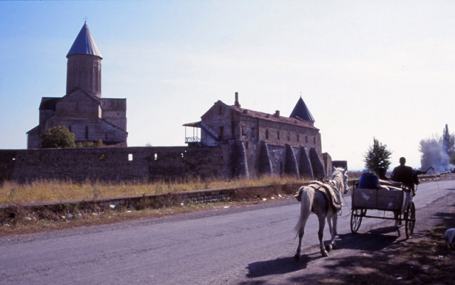 A horse-drawn cart passes the 11th century Alaverdi Monastery