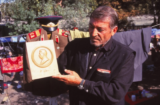 Tarzan, a stallholder at the Dry Bridge Fleamarket in Tbilisi, offers a Stalin plaque for 50 lari (NZ$20)