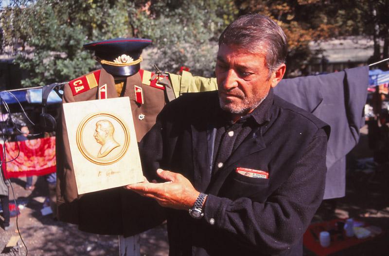 Tarzan, a stallholder at the Dry Bridge Fleamarket in Tbilisi, offers a Stalin plaque for 50 lari (NZ$20)