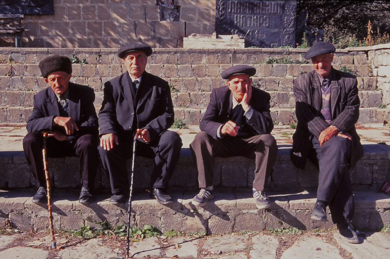 Men enjoy the sunshine in Lahıc