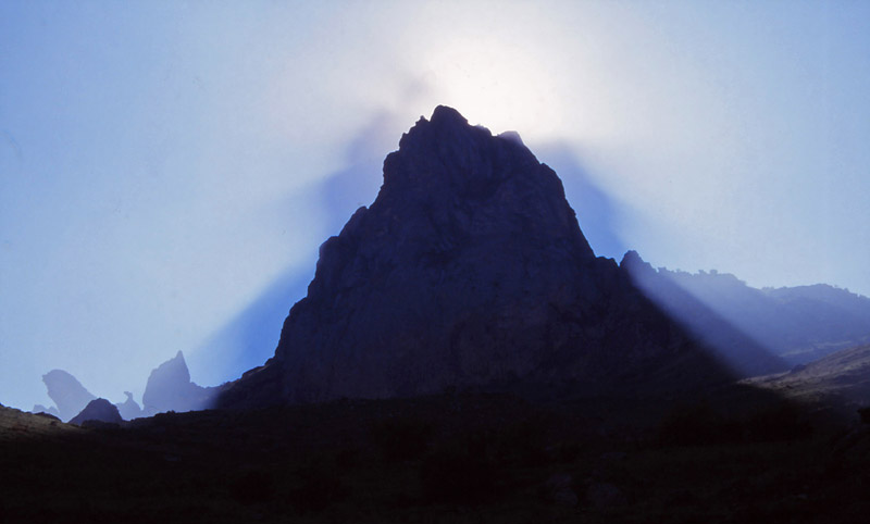 The sun plays tricks with the sacred Five-finger Mountain (Beşbarmaq Dağ)