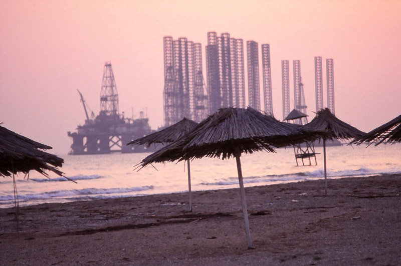 Oil rigs loom off Baku's premier swimming spot, Şixov Beach