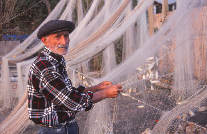 A Caspian Sea fisherman repairs a net at Lenkeran