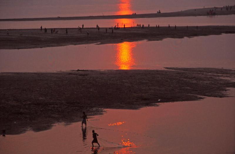 Children fish and play football on sandbars in the Mekong River, Vientiane. Photo: Peter de Graaf