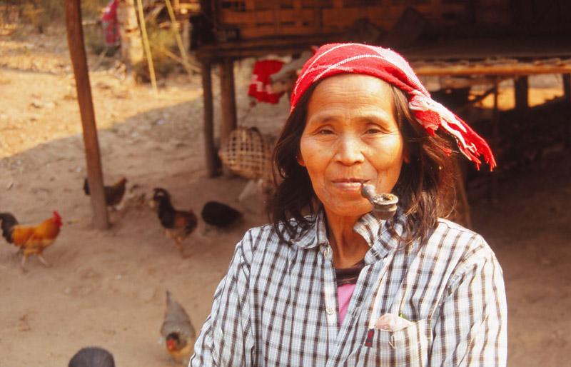 A woman enjoys a pipe in Ban Nalan Neua village