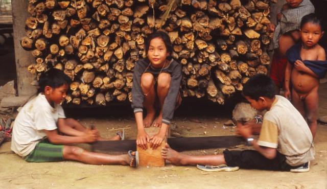 Kids saw timber in Huay Boy village