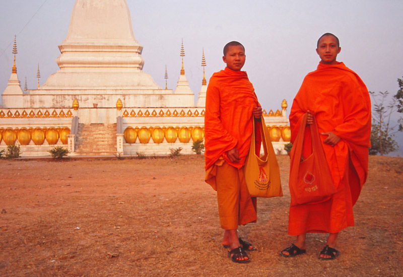 Monks at Phu That stupa in Udomxai, northern Laos.
