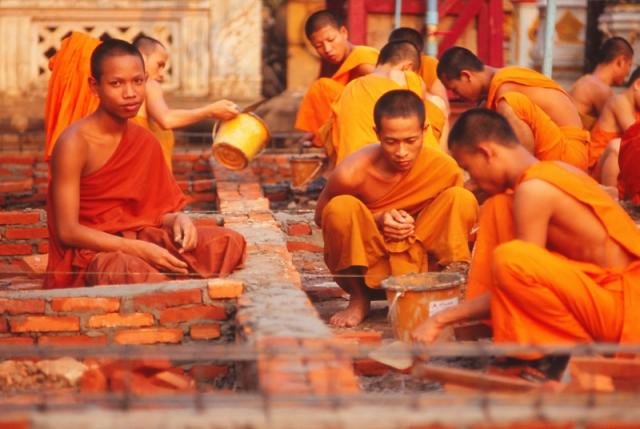 Monks build a toilet block at Wat Luang Monastery, Pakxe.