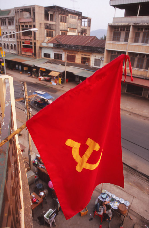 Communist flag outside my $2.50-a-night hotel room in Pakxe